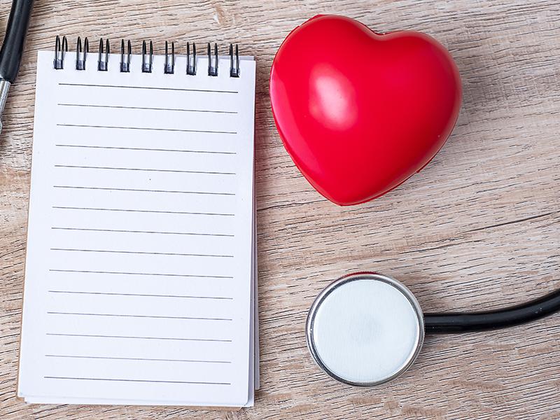 Photo of notepad and stethoscope for UArizona Health Screening